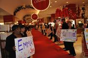Hand-made signs and a cheering crowd lined the red carpet to give Emma a VIP welcome at Macy's in D.C.