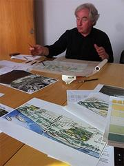 Architect Steven Holl working on the concept for the Kennedy Center expansion. Holl frequently works with watercolors to illustrate his designs. He specializes in seamlessly integrating new projects into contexts with particular cultural and historic importance.