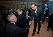 CIA Director David Petraeus shakes hands with attendees.