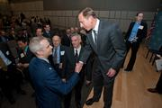 George Mason University officially dedicated Founders Hall on the Arlington campus March 8. CIA Director David Patraeus, shown here shaking hands with attendees, was the keynote speaker.