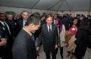 CIA Director David Petraeus greets attendees.