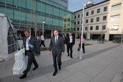 CIA Director David Petraeus departs after speaking at the dedication.