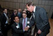 Director of the Central Intelligence Agency General David H. Petraeus shakes hands with Arlington County Board Member Walter Tejada at the dedication.