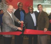 Sport&Health Club President and CEO Mark Fisher, from left, former Washington Redskin and Hall of Famer Art Monk, Gainesville Sport&Health's Will Spencer and Gainesville District Supervisor John Stirrup cut the ribbon at the grand opening of Gainesville Sport&Health.