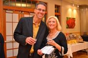 Glenn Parisi and his wife Dr. Christine Sofie participate in FACETS' A Taste of Fall silent auction to benefit Fairfax's homeless.