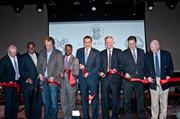 Cutting the ribbon at The Hamilton's grand opening were, from left, Clyde's Managing Director David Moran, D.C. Councilmember Vincent Orange, Clyde's President Thomas Meyer, D.C. Council Chairman Kwame Brown, D.C. Mayor Vincent Gray, D.C. Councilmember Jack Evans, Ward 2, Kevin Kuzemchak of Shorenstein Properties and Clyde's CEO John Laytham.