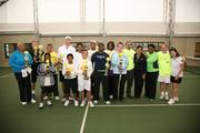 """Past and present D.C. mayors, community leaders and local celebrities participated in the """"Heart To Hart Tennis Experience"""" on Oct. 29 at the Southeast Tennis and Learning Center in the District. The event, founded and hosted by The Recreation Wish List Committee in partnership with the D.C. Department of Parks and Recreation, featured a daylong tournament of doubles tennis matches. From left, D.C. Councilmember Yvette Alexander, Ward 7; NBC 4 news anchor Jim Hanley; NBC 4 reporter John Schriffen; tennis player Kavi Sud; D.C. Council Chairman Kwame Brown; tennis player Vivian Coto; Department of Parks and Rec Director Jesús Aguirre; director of tennis programs at STLC Jeri Ingram; CEO and founder of RWLC Cora Masters Barry; WTOP news anchor Mark Plotkin; and president and general manager of NBC4 Jackie Bradford; pose with Southeast Tennis and Learning Center tennis scholars."""