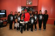 Reed Smith Managing Partner A. Scott Bolden poses with Southeast Tennis and Learning Center scholars following the dedication of the A. Scott Bolden Roundroom at the 13th Annual Heart to Hart Tennis Experience on Oct. 29.