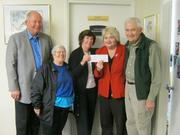 On Oct. 26, members of Heritage Presbyterian Church's mission committee, from left, John Kohout, Joan Coe, Susan Palmer and Bob Trimble, presented United Community Ministries' Executive Director Cynthia Hull with a donation of $1,000 to provide assistance to those impacted by flooding in the Huntington area of Fairfax County in September.