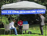 Health care reform advocates interview people about their experiences with the health system at tent outside United Methodist Building, across the street from the Supreme Court.