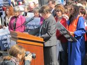 Supporters of health care reform pray outside the Supreme Court Monday.