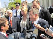 Ohio Attorney General Mike DeWine, right, speaks to reporters following Monday's oral arguments at the U.S. Supreme Court.