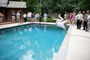 The Northern Virginia Technology Council invaded the normally quiet streets of McLean June 28 for the tropically-attired Hot Ticket Awards at NVTC CEO Bobbie Kilberg's poolside patio. And it's not a party until someone lands in the pool fully clothed.