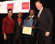 From left, Argelia Rodriguez of D.C. College Access Program; Ajamu Clark, DC-CAP advisor; third-place winner Darrell Ball from Luke C. Moore Academy High School; and Laurent Ross of Calvert Investment Distributors Inc. Ball received $1,000 in D.C. College Savings Plans.