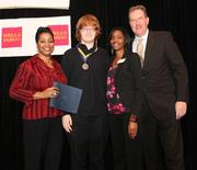 From left, Argelia Rodriguez of DC-CAP, second-place winner Kieran VIckers from Duke Ellington High School, DC-CAP advisor Shenita Denison and Laurent Ross of Calvert Investment Distributors.