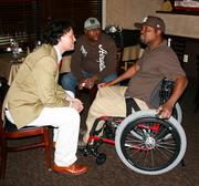 Duke Leopold d'Arenberg talks with Army Reservist Dwayne Cole who was injured in Iraq.