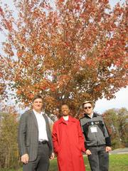 JBG Rosenfeld Retail, developers of the Tysons West mixed-use project, donated 12 trees to the Hunter Mill District of Fairfax County. Jay Klug of JBG Rosendeld Retail, left, Cathy Hudgins, Fairfax County supervisor of the Hunter Mill District, and Andy Galusha of the Fairfax County Planning and Development stand under a red maple from Tysons West, newly transplanted at Stratton Woods Park by Move My Trees.