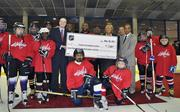 Washington Capitals forward Joel Ward visited Fort Dupont Ice Arena on Nov. 28 to announce that Neal Henderson has been named Friends of Fort Dupont Ice Arena's new hockey director, combining his Fort Dupont Ice Hockey Program, which includes the Cannons Hockey club, with Friends of Fort Dupont Ice Hockey Program.