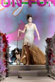 Fashion For Paws model Gabrielle Fronce with her dog Emmi. Fronce raised $10,475 for WHS, wearing Aram from Tyson's Galleria. Emmi the dog was styled by Wagtime DC.