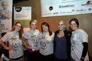 Paige Miskin, second from right, post-head shave with other event attendees.