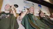 NetApp employees, from left, Michael Yalove, Michael Poulton and Paul Thelan, shaved their heads for the cause.