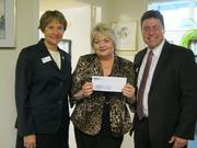 On Nov. 17, Christine Todd and Jon Wolford from the Northern Virginia Association of Realtors presented a $10,000 donation to United Community Ministries' Executive Director Cynthia Hull, center, to be used to purchase food for UCM's food pantry.