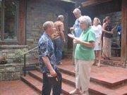 NVTC Bobbie Kilberg greets guests on the porch.