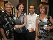 From left, Ed Durbin of Airwatch, and Melissa Adanson, Tom Bruno and Carole Scott, all of Agilex Technologies