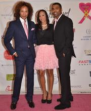 On Oct. 8, Paul Wharton, left, of Real Housewives of D.C. fame, hosted A Night of Pink Hope, an event benefiting We Believe Foundation's Pink Hears of Hope Fund for breast cancer. Wharton is shown here with national recording artists Sole, center, and Ginuwine.