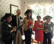 From left, Sheila Rabaut and Tom Rabaut of the Rabaut Family Foundation, Debbie Howard, Sharon Canner of CHIME and volunteer on the benefit's planning committee and Ann Barcome of Dozier Technologies Inc. Rabaut Family Foundation was a sponsor of the 17th Annual PRS Kentucky Derby Benefit.