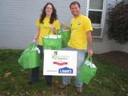AmeriCorps' Dorothy Shepard and Ryan Baetsen deliver free Energy Efficient Kits to low-income homeowners during Rebuilding Together Alexandria's Energize Alexandria event.