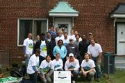 A team of Rebuilding Together Alexandria volunteers from the Structural Engineering Association provided free home repairs to a low-income homeowner and veteran during National Rebuilding Day.