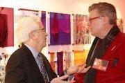 Washington Business Journal Publisher Alex Orfinger, left, and Ken Baker of Gensler D.C. catch up at Gensler's Red Party in front of Mindy Weisel's art exhibit.