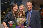 From left, Grace Lee, Caren Holmberg and Dr. Bob Leipzig, all with Smiles at Reston Town Center.