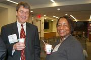 Reston Association's Andy Sigle and FACETS' Amanda Andere.