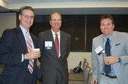 From left, Michael Ferraro of Training Solutions Inc. and chair-elect of the Greater Reston Chamber of Commerce Board of Directors; Mike Jennings of Business Engineering Inc. and member of the Greater Reston Chamber of Commerce Board of Directors; and Paul Yeloushan of Virginia Commerce Bank.