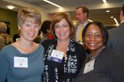 The Greater Reston Chamber of Commerce, in partnership with Reston Association, hosted a meet-and-greet Oct. 27 with candidates for the Virginia General Assembly. Each candidate was given two minutes to address the audience. Attendees included, from left, Tracy White of Reston Hospital Center, Kerrie Wilson of Reston Interfaith and Amanda Andere of FACETS.