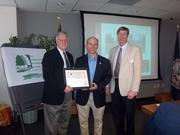 Herndon received an award for its bio-retention pond at Runnymede Park. Shown here, from left, Bob Boxer, Herndon director of public works; Steve DeBenedittis, Herndon Mayor; and John Muse, president of the Community Appearance Alliance.