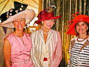 Among those sporting the springtime attire were Women's Committee members, from left, Caroline Boutte, Sally Akridge and Donna Chapman.
