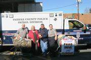 On Nov. 7, Officer Eddy Azcarate, United Community Ministries Executive Director Cynthia Hull, UCM Food Manager Jose Fratti and Officer Julia Elliott celebrated a food drive held by the Franconia Station of the Fairfax County Police Department. The officers delivered nearly 5,000 pounds of food and $300 in gift cards to UCM.