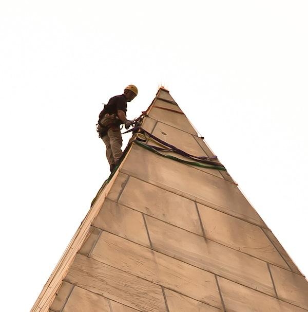 An engineer inspects the Washington Monument in 2011 after an earthquake caused damage to the landmark.