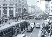This view is looking east down F Street NW in 1939. Holiday shoppers are out and the Woodward & Lothrop department store is on the left. The building's distinctive facade was designed by Henry Ives Cobb and the features of leaded glass flower designs and the Woodward & Lothrop monogram can still be seen today.