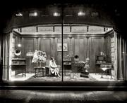 Display window at the Woodies flagship store in D.C., circa 1928. A large display department was kept at work constantly inventing dramatic window exhibits. The store also contained a dining room, beauty parlor, travel agency, messenger service and tourist information desk. Beginning in 1890, the store showed free art exhibits.