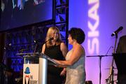 Cherie Pleasant, left, of AGC-DC and Mindy Lyle of Haley & Aldrich, both from the ball's organizing committee, announced the candidates for the King and Queen of the 2011 Builders' Ball.