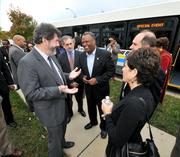Prince George's County Executive Rushern Baker chats with bus tour attendees.
