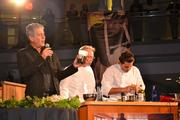 From left, Anthony Bourdain, with battling chef Brian McBride and his sous chef.