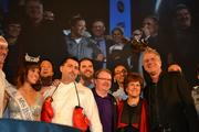The champion of Capital Food Fight, Haidar Karoum, center, celebrates with the judges and other competing chefs.