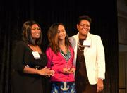 Lidya Abune, center, a student at Coolidge Senior High School, accepts her award from Tracey Jarmon, left, philanthropic advisory services officer for The Community Foundation for the National Capital Region, and Terri Lee Freeman, right.