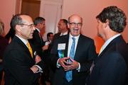Ed Offterdinger of Baker Tilly Virchow Krause LLP, center, with Dennis Cotter of Davis Construction, right, and a guest.
