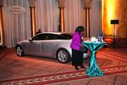 A silver Jaguar that guests took photos with.